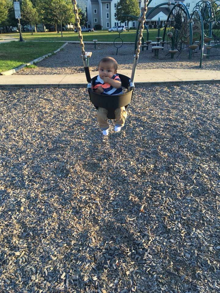 Infant Ky'mani Moore in a swing