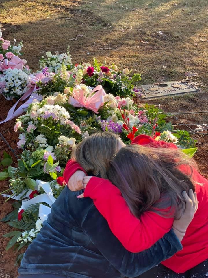 Cameron Gantt and Kristin Fridley Gantt at Fallon Fridley's grave