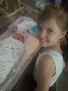 Autumn Hallow with her newborn sister