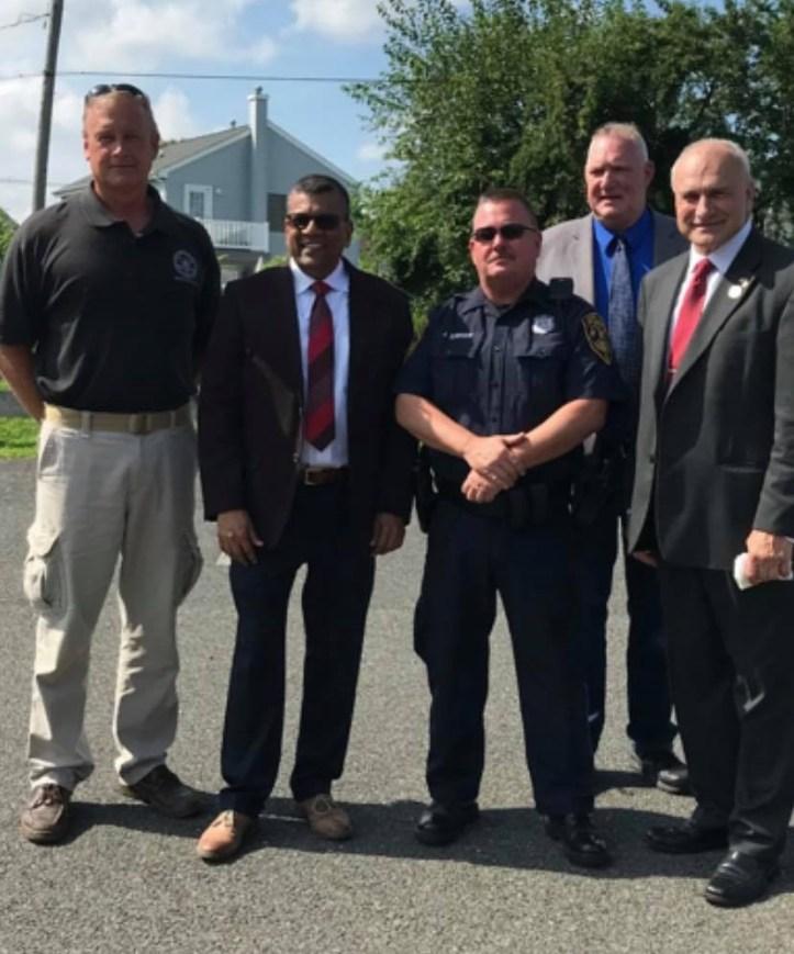 David Gregor on left with law enforcement pals