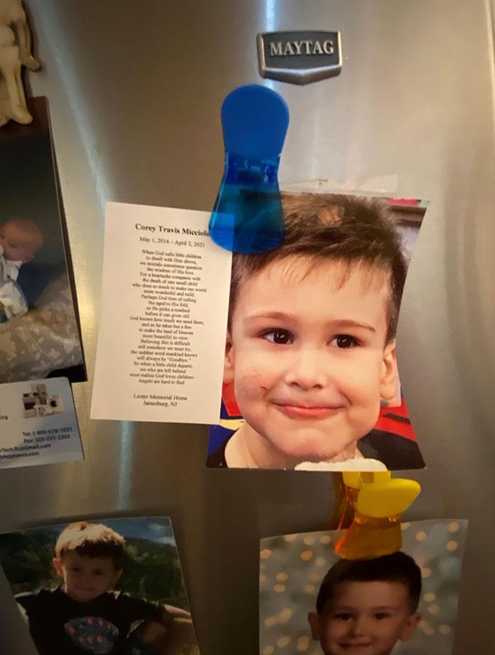 Corey Micciolo photos on family refrigerator