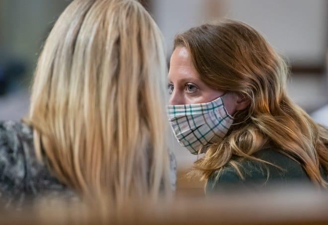 Mara Mischler confers with Sarah Schryer. (Matt Dayhoff/Journal-Star)