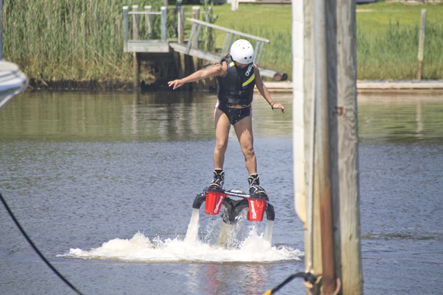 Maria Loja of Queens tries the Flyboard for the first time. (Credit: Paul Squire)