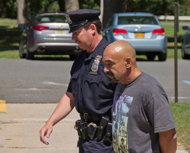 Robert Sullivan is led into Southold Town Thursday afternoon. (Credit: Paul Squire)