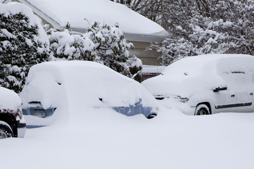 KATHARINE SCHROEDER FILE PHOTO | Cars piled with snow in Cutchogue.