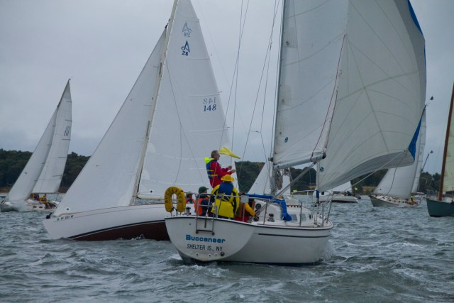 The sailboat Optimistic, seen here on the left with sail number 148  behind a fellow racer Buccaneer, jockeys for position before Saturday's Whitebread race. The boat would later sink off Shelter Island in rough seas.