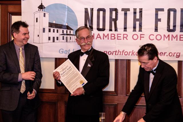 From left, Suffolk County Legislator Al Krupski, Bob Scott and North Fork Chamber of Commerce president Tom Scalia.