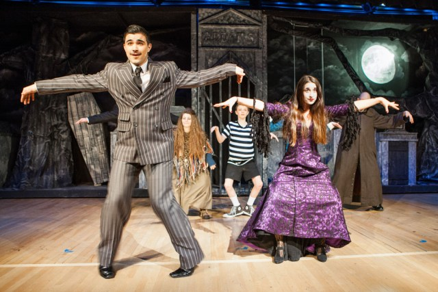 Gomez and Morticia Addams, played byWilliam Tondo and Winter Wilcenski, lead their family members in a song and dance during a rehearsal for 'The Addams Family.' (Credit: Katharine Schroeder)