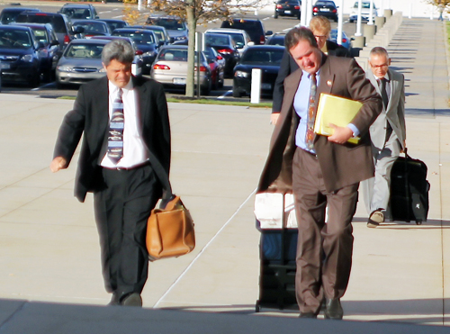 JENNIFER GUSTAVSON PHOTO | Anthony Claudio, right, and attorney Frank Blangiardo enter the federal courthouse in Central Islip last October.