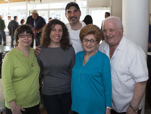 Fundraiser organizer (from left) Debbie Volinski and Hellenic owners Maria, George, Anna and John Giannaris. (Credit: Katharine Schroeder)