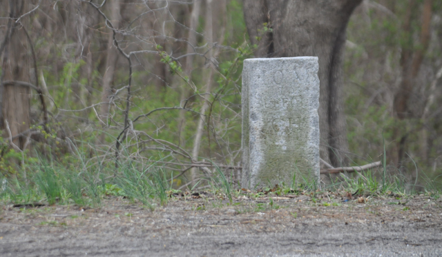 This mile marker in Mattituck marks 10 miles to the Suffolk County Courthouse. (Credit: Grant Parpan)