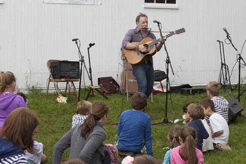 Brady Rymer entertains the kids at Saturday's fundraiser at Hallockville Museum Farm. (Credit: Katharine Schroeder photo)