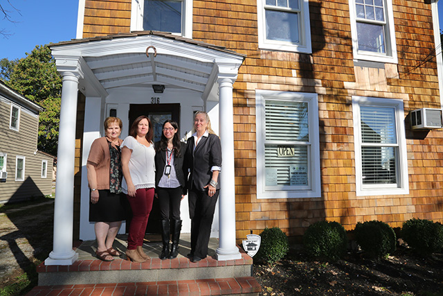 From left: Linda Ruland, Colleen Cummings, Elizabeth Petersen and Sarah Benjamin stand outside of their new building on Friday morning. (Photo: Krysten Massa)