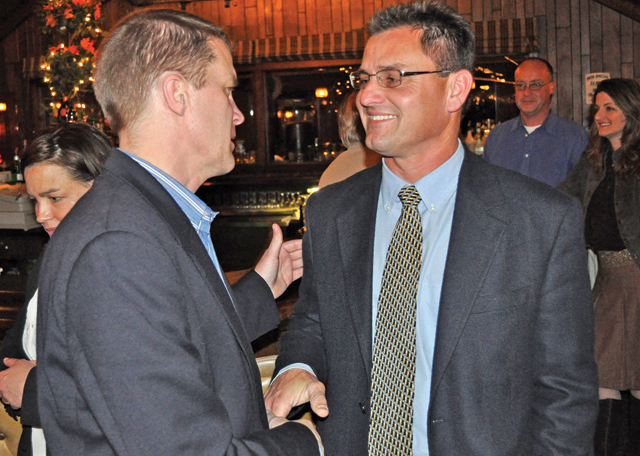 Town Supervisor Scott Russell, left, congratulates former councilman Chris Talbot at the Soundview Inn on Election Day 2009. The two will return to the Greenport restaurant May 21 for a nominating convention that will determine who will get the Republican nomination for supervisor this year. (Credit: Tim Kelly file)