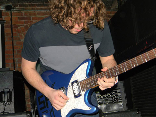 Chris Krasnow playing guitar. (Courtesy photo)