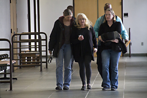 Christine Stulsky, center, was released on $10k bond on Friday. (Credit: Paul Squire)