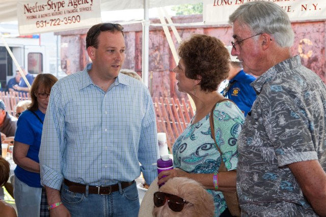Congressman Lee Zeldin stopped by for a visit. He is shown here talking to Doris and Ron McGreevy of Mattituck. (Credit: Katharine Schroeder)