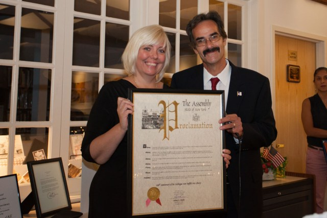 Dennis Noncarrow presents a proclamation on behalf of Assemblyman Anthony Palumbo, who could not attend. (Credit: Katharine Schroeder)