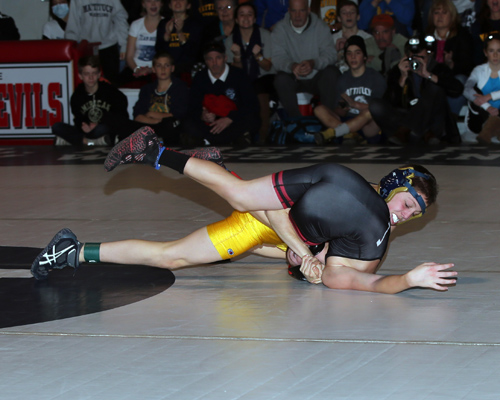 Jack Bokina of Mattituck defeated Donald Wood of Center Moriches in the 99-pound weight class. (Photo credit: Daniel De Mato)