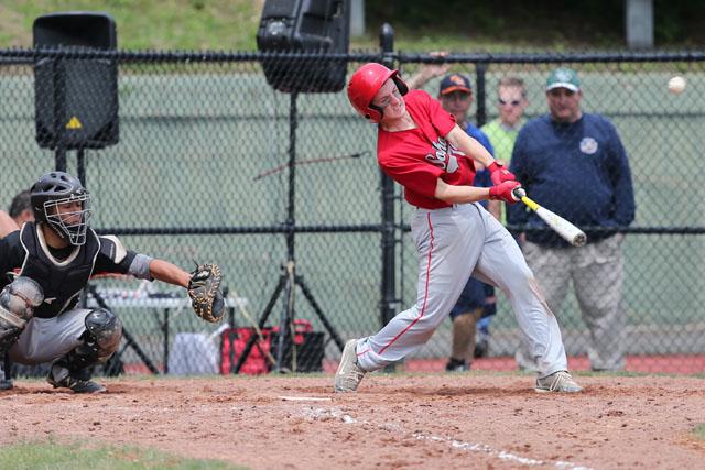 Noah Mina hits the ball hard against Tuckahoe. (Credit: Daniel De Mato)