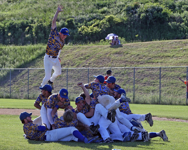 The Mattituck baseball team celebrates its 4-1 win over Livonia in the Class B state finals Saturday afternoon. (Credit: Daniel De Mato)