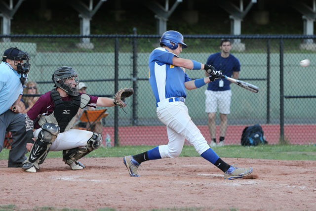 Chris Dwyer hits a double and drives in three runs in the 10th inning, putting Mattituck ahead 8-4. (Credit: Daniel De Mato)
