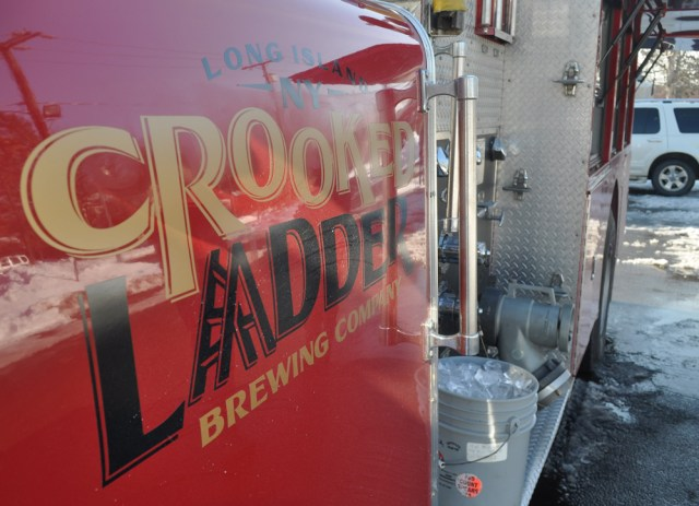 The Crooked Ladder beer truck can serve up to four microbrews at a time. The company plans to soon add a television and grill to the custom-fitted fire truck.