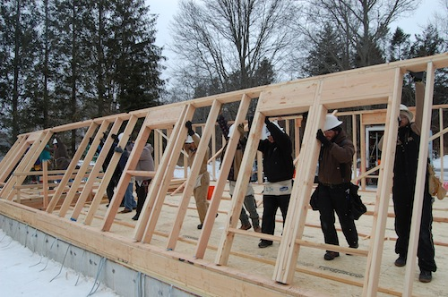 Volunteers help erect the home's back wall. (Credit: Cyndi Murray)