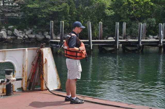 A Fishers Island ferry employee gets set for arrival to the island.