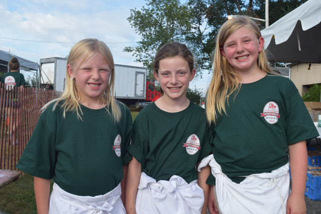 Reese Pearsall, 7, of Cutchogue, Jocelyn Kaelin, 9, of Southold and Emma Pearsall, 9, of Cutchogue all volunteered their time at Saturday's barbecue.