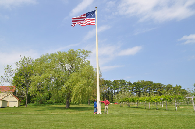 Dan and Prudence Heston next to the flag pole at their Salt Air Farm in Cutchogue. (Credit: Grant Parpan)