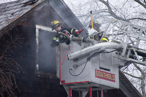 Members of four different fire departments responded to a fire in Southold on Tuesday. (Credit: Paul Squire)