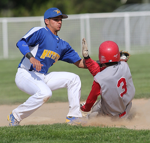 Shortstop Marcos Perivolaris applies the tag against Center Moriches. (Credit: Garret Meade)