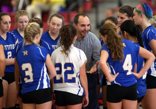 Coach Frank Massa talks to his team during a stoppage in play.