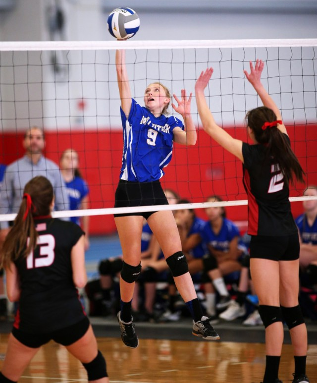 Senior Dawn Rochan looks to slip one past two opponents.