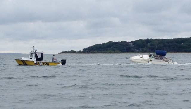 A Sea Tow boat tows the boat Saturday morning following the accident Friday night. (Credit: Sonja Reinholt Derr)