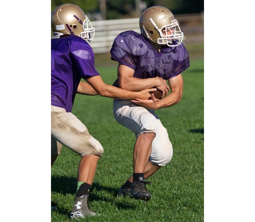 Billy McAllister, taking a handoff from Dylan Marlborough, is the Porters' new feature back. (Credit: Garret Meade)