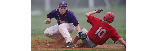 Southold's Dylan Clausen slides into third base safely while Greenport's Keegan Syron covers the bag. (Credit: Garret Meade)