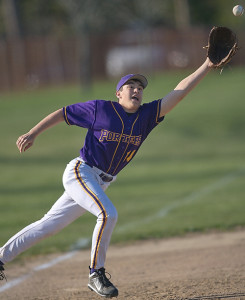 GARRET MEADE FILE PHOTO | Matt Drinkwater, lunging for a ball while playing third base last year, is a returning starter for Greenport.