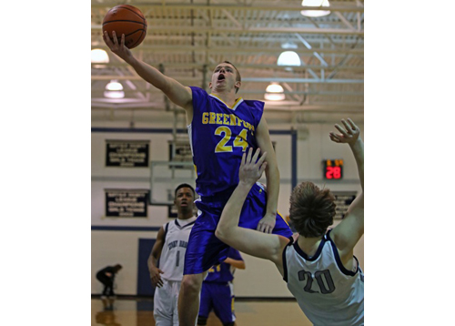 DANIEL DE MATO PHOTO | Austin Hooks of Greenport attempting a layup over the off-balanced Andrew Daniel of Stony Brook during Thursday's game.