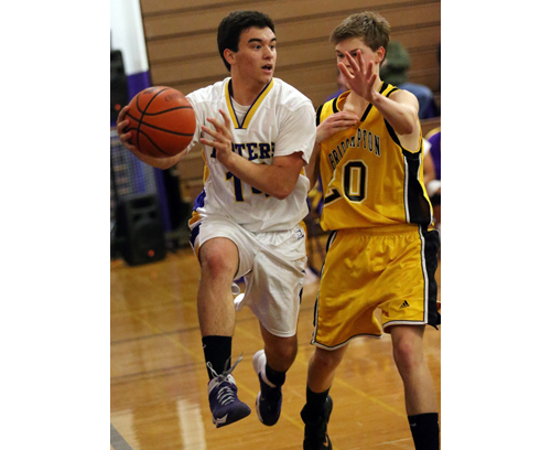 Greenport's Matt Drinkwater looks for someone to pass to while being guarded by Bridgehampton's Matt Hostetter. (Credit: Garret Meade)