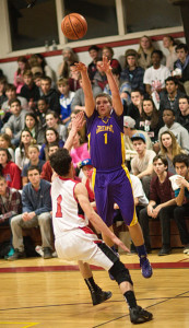 GARRET MEADE PHOTO | Timmy Stevens of Greenport, firing a shot over Pierson's Ian Barrett, led the Porters with 17 points.
