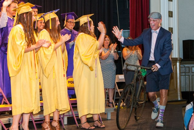 Beloved history teacher Ron McEvoy made a spectacular entrance at Sunday's graduation.
