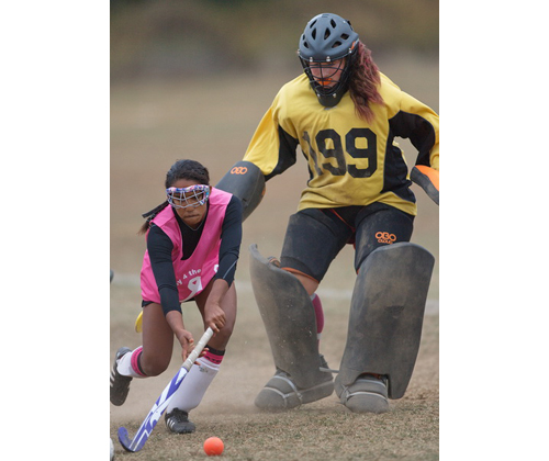 GARRET MEADE PHOTO | Greenport/Southold's Adrianna Chandler attempts to clear the ball in front of her goaltender, Brandi Gonzalez.
