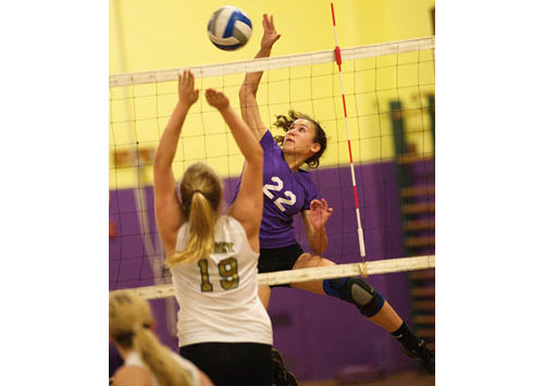 GARRET MEADE PHOTO | Greenport/Southold's high-flying outside hitter, Marina DeLuca, tries to direct the ball past Bishop McGann-Mercy's Emily St. Louis.