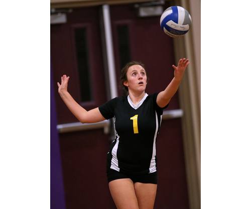 Sam Henry, one of Greenport/Southold's eight seniors, prepares to serve. Henry made 13 digs against Bishop McGann-Mercy. (Credit: Garret Meade)