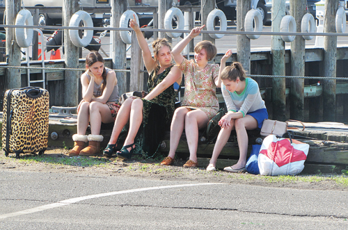 CYNDI MURRAY FILE PHOTO | The four stars of the HBO series 'Girls' — Zosia Mamet (from left), Jemima Kirke, Lena Dunham and Allison Williams — film a scene on the Greenport harborfront in June.
