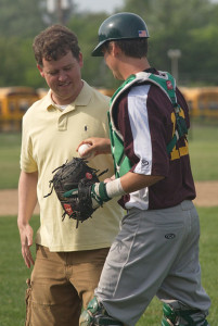 GARRET MEADE PHOTO | The Hamptons Collegiate Baseball League president, Brett Mauser, was handed the ball by Riverhead Tomcats catcher Jason Gordon after throwing the ceremonial first pitch.