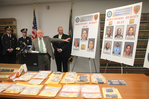 District attorney Thomas Spota points to the suspects arrested in a heroin trafficking ring at a press conference Wednesday. (Photo by Paul Squire)