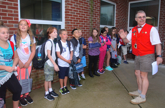 "Fourth grade teacher Skip Munisteri, now in his 22nd year, gathers his class outsise so they can all go in together. ""I start from the first day that we are a team- we all go in together."""